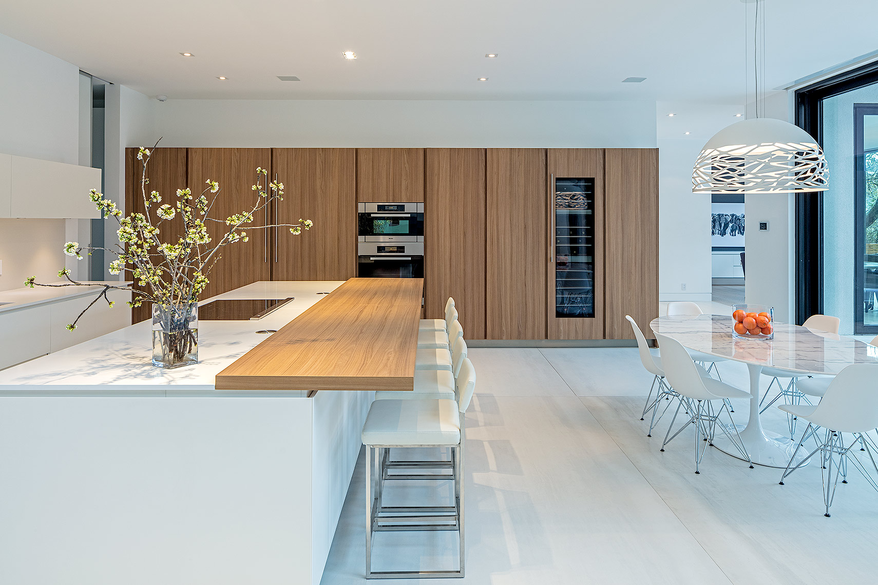 Modern kitchen in white and light wood by Peter A. Sellar Architectural Photographer