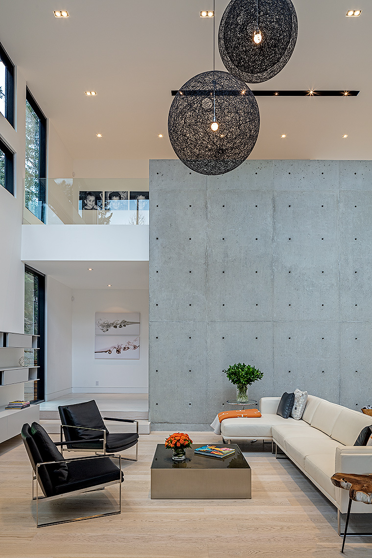 Living room with a concrete wall by Peter A. Sellar Architectural Photographer