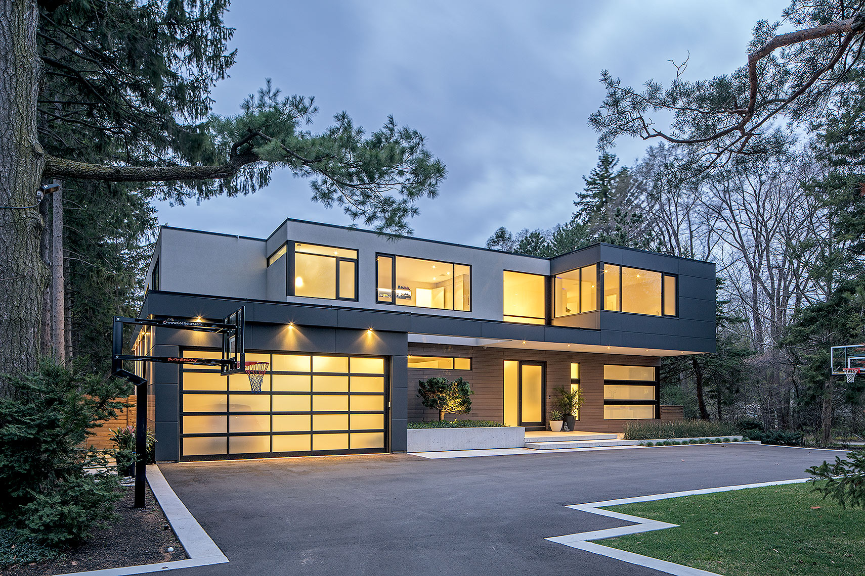 Front facade of a modern house at dusk, Peter A. Sellar Architectural Photographer
